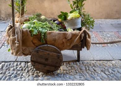 Medieval market stall selling vegetables