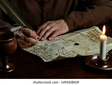medieval Monk Hands write a letter