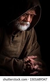 Medieval monk pensive in prayer
