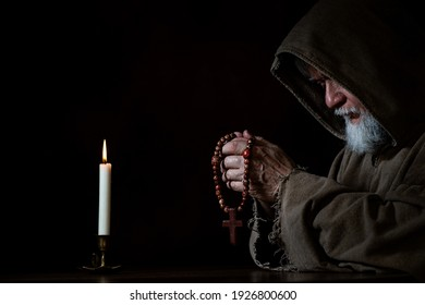 A Medieval monk with rosary