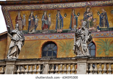 Medieval mosaics and sculpture on facade of Santa Maria in Trastevere - Rome, Italy