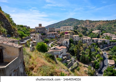 The medieval mountain village of Savoca in Sicily with its Bar Vitelli right in the middle, known as movie location of Godfather, a sunny day in summer, panoramic view from church San Nicolo