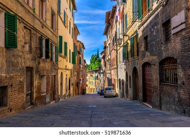Medieval narrow street in Siena, Tuscany, Italy. Siena is capital of province of Siena. Historic centre of Siena has been declared by UNESCO a World Heritage Site Architecture and landmark of Siena.