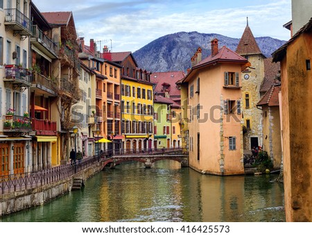 Medieval old town and the tower of Palais de l'Isle castle on Thiou river in Annecy, Savoy, France