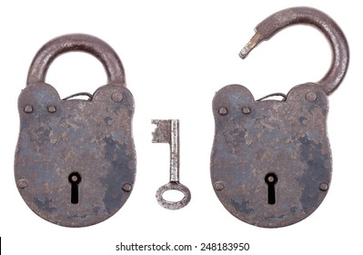 Medieval padlock with key, made of iron and slightly rusty. Portable lock with a shackle that may be passed through an opening to protect against unauthorized use, theft, vandalism or harm.