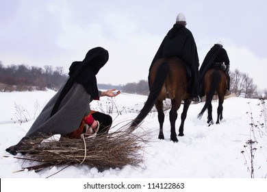 Medieval peasant with a firewood bundle and riding knights Hospitallers