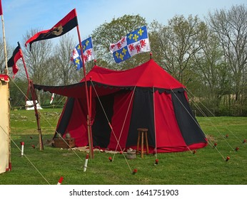 Medieval red and black war tent with normandy flags waving
