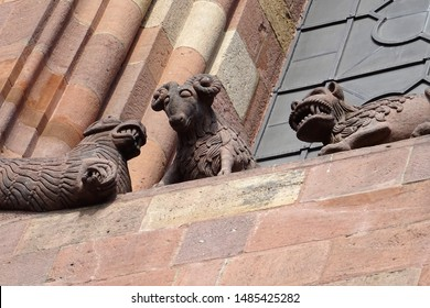 Medieval religious art - lamb and predators (lions) - from the east facade of the 11th-century CE cathedral of Worms (Germany).