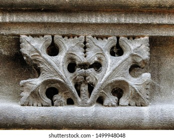 Medieval sandstone ornament depicting  an abstract leaf motif, carved into a decorative frieze on the upper part of the Chester Cathedral facade. City of Chester, Cheshire, England