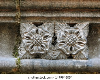 Medieval sandstone ornament depicting an abstract floral pattern, carved into a decorative frieze on the upper part of the Chester Cathedral facade. City of Chester, Cheshire, England