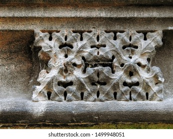 Medieval sandstone ornament depicting a geometric leaf pattern, carved into a decorative frieze on the upper part of the Chester Cathedral facade. City of Chester, Cheshire, England
