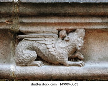 Medieval sandstone ornament depicting a winged lion, carved into a decorative frieze on the upper part of the Chester Cathedral facade. City of Chester, Cheshire, England