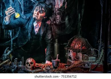 Medieval scientist creates a magical elixir in his laboratory. Alchemist. Halloween.