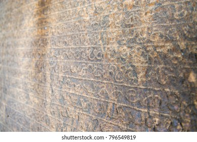 Medieval sinhala inscription on the flat stone surface with shallow depth of fields
