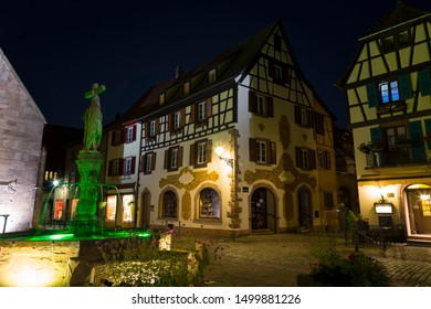 Medieval small town Kaysersberg, region Alsace at night. France. Colorful  street in old village, medieval architecture. Tourism on the Alsace Wine Route. Famous tourism destination, tourist landmark.