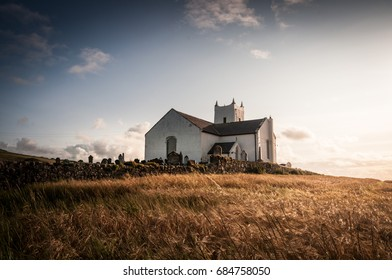 Medieval small white church on North coastal way in Northern Ireland