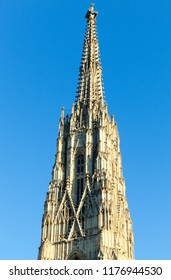 The medieval spire of St. Stephen's Cathedral in a sunset light (Vienna, Austria).