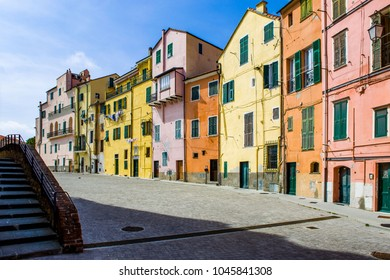 Medieval square with painted house in the Parasio, the old town of Porto Maurizio, Imperia