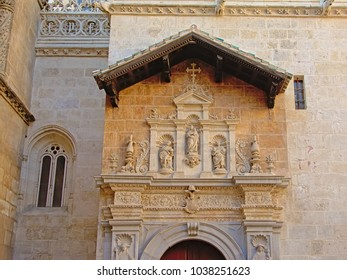 MEdieval statues of Saints above a door of the Royal Chapel of Granada, Spain on a sunny day with clear blue sky