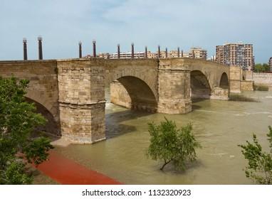 Medieval Stone Bridge (Puente de Piedra ) across river Ebro in Zaragoza, Spain