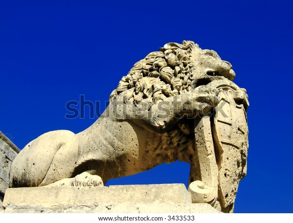 Medieval stone sculpture of lion guarding the gates of the old city of Mdina in Malta