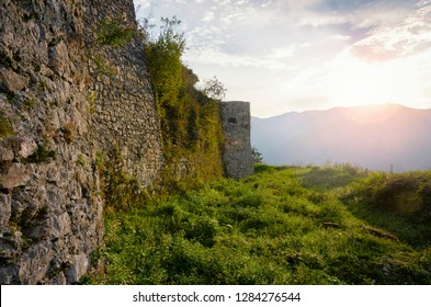 Medieval stone wall at the sunset. Castle on Kozlov Rob in Tolmin, Slovenia