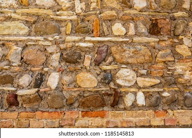 Medieval stonework in a castle in Sirmione Lake Garda, Italy. Layered Italian stonework brown and multi colours