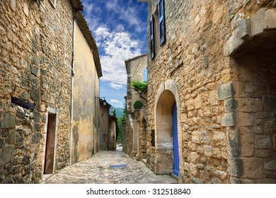 Medieval street in beautiful village of Lacoste after an evening rain. Lacoste is best known for its most notorious resident, Donatien Alphonse Francois comte de Sade, the Marquis de Sade
