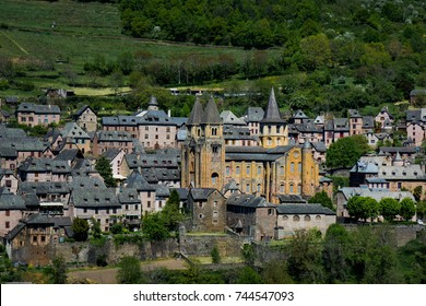 Medieval street in Conques in France. Beautiful village in the South of France with cooblestone streets and roman houses.