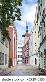 Medieval street in old Riga city, Latvia, Europe. Riga is the capital and largest city of Latvia, a major commercial, cultural, historical and financial center of the Baltic region