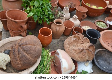 medieval style pots, jugs and food prepared outside