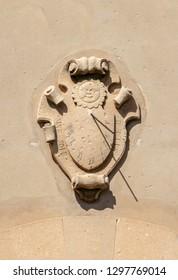 A medieval sundial on an old house facade on the Spanish island Mallorca
