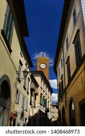 Medieval Torre del Moro (Moro Tower) with old clock, one of Orvieto landmarks seen from the city center narrow street