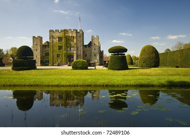 Medieval tower of a Tudor Hever Castle in England, mirroring in water on a beautiful day
