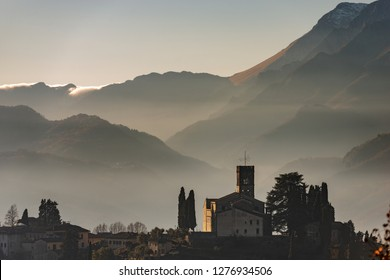 Medieval town of Barga with the Cathedral of Saint Christopher (Collegiata di San Cristoforo) and the Apuan Alps (Alpi Apuane) in Tuscany, Lucca province, Italy, Europe