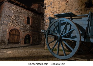 Medieval town at night with horse cart, doors, old houses and lights