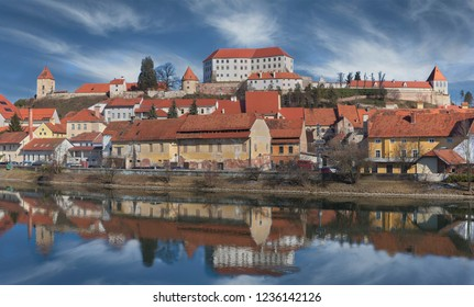 Medieval town Ptuj with mighty  castle on the hill and reflections in river Drava, Slovenia