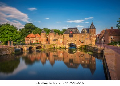 Medieval town wall and gate named Koppelpoort and the Eem river in the historical center of Amersfoort, Netherlands. Long exposure.