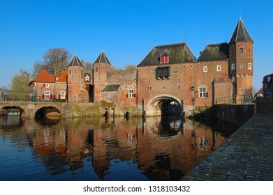 Medieval town wall and gate named Koppelpoort and the Eem river in the historical center of Amersfoort, Netherlands.