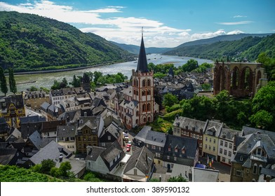 Medieval village Bacharach. City panorama from hill, covered by vineyard. Rhine valley, Germany.