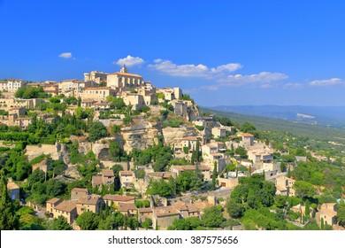 Medieval village of Gordes with historical buildings on a hillside, Provence-Alpes-Cote d'Azur, France