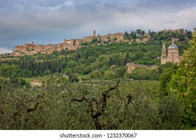 The medieval village of Montepulciano. View of the church Madonna di San Biagio and of the hilltop town of Montepulciano in Tuscany, Italy