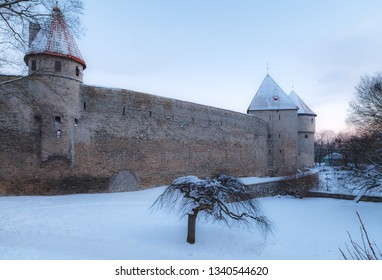 Medieval wall with towers. Snowy old town of Tallinn