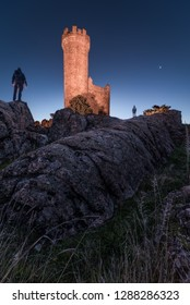 Medieval watchtower at dawn on rocky hill of the village of Torrelodones in Madrid,Spain
