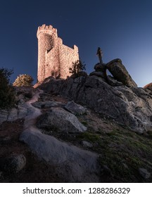Medieval watchtower at night on rocky hill of the village of Torrelodones in Madrid,Spain