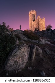 Medieval watchtower at twilight on rocky hill of the village of Torrelodones in Madrid,Spain