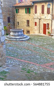 Medieval well in the historical village of Castiglione d'Orcia, Tuscany, Italy