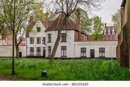 Medieval white houses in the Beguinage (Begijnhof) in Bruges (Brugge), Belgium