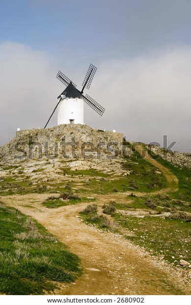 Medieval windmill dating from the 16th century on a hill overlooking the town of Consuegra in Toledo province, Castilla La Mancha, central Spain.