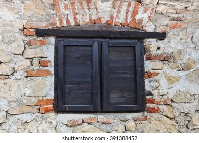 medieval window into an ancient stone wall